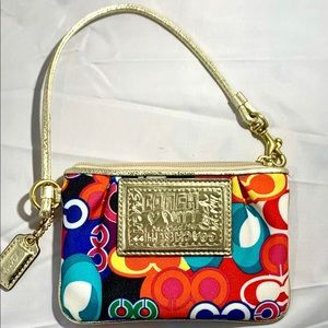Coach poppy multicolored wristlet with gold trim